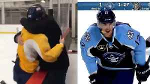 News video: Hockey Player Gets a Big Hug as He Tells His Dad He's Going to the Olympics