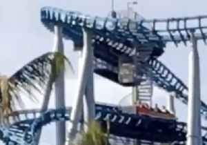 News video: People Stuck on Roller Coaster Due to Power Outage at Sea World Gold Coast
