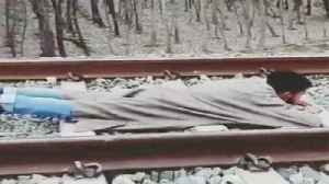 News video: Death-defying stunt: Young Kashmir man lies on railway track as speedy train passes over him