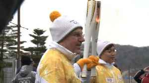 News video: IOC President Bach carries Olympic flame