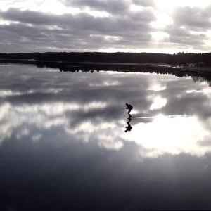 News video: Guy Skates Across Reflection of Clouds on Frozen Lake