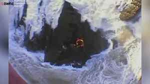 News video: Dramatic Coast Guard Rescue of Men Clinging to Rocks Captured on Video