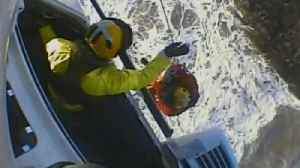 News video: Coastguard Fights 6-Foot Waves In Dramatic Rescue of Two Men Stranded on Rocks