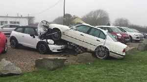 News video: BMW leaves road and crashes into Mini on garage forecourt