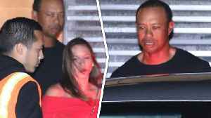 News video: Tiger Woods And His Girlfriend Look Kinda Happy?
