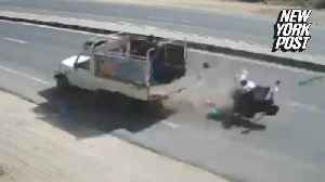 News video: Family goes flying after motorcycle is rammed by a truck