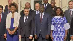 News video: Soccer stars and Liberia's new president arrive at Elysee Palace