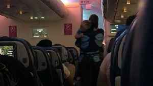 News video: Viral Video Shows Flight Attendant Calming Down Toddler on Late-Night Flight