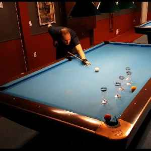 News video: Guy Shows Off Impressive Pool Trick Shots