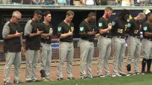 News video: A moment of silence at spring training to honor the victims of last week's school shooting in Parkland, Florida