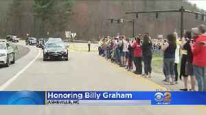 News video: Admirers Salute Billy Graham As Motorcade Crosses North Carolina