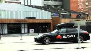 News video: Huawei's AI-powered smartphone drives a Porsche