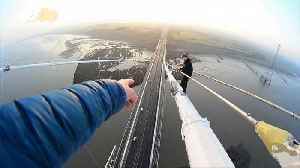 News video: Don't Look Down! Daredevils Get Dragged for Reckless Behavior After Climbing Huge Bridge