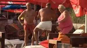 News video: Elderly people at the beach dance to rap music