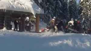 News video: Snowmobiler crashes into fellow rider while parking at the cabin