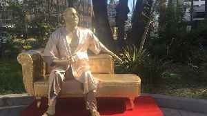 News video: Gold Statue of Harvey Weinstein With His 'Casting Couch' Appears Near Oscars Venue
