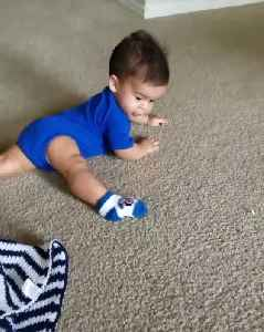 News video: Baby Boy Spins Around Floor Chasing His Foot