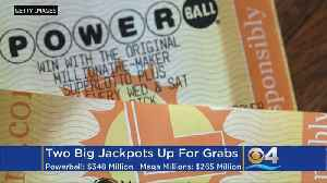 News video: Dueling Jackpots Rise To Combined Total Of $613 Million