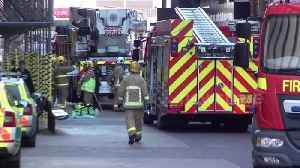 News video: Fire service arrives at Blackpool Tower after fire traps 12