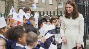 News video: Pregnant Kate Middleton Recycles White Maternity Look for Charity Visit