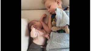News video: Soothing Baby Sister Puts Her Big Brother To Sleep