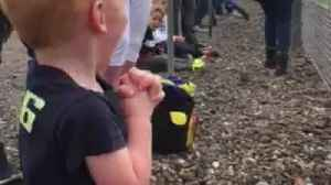 News video: Little boy gets thrill of a lifetime during GP motorcycle race