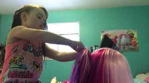 News video: Little girl's humorous and informative ponytail hair tutorial