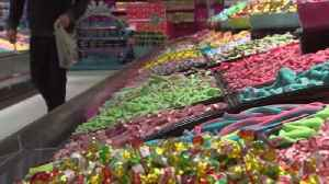 News video: Crossing the border... for sweets