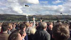 News video: Race-goers watch the action as Cheltenham Festival gets underway