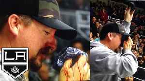 News video: LA Kings Fan Takes Hockey Puck To The FACE!