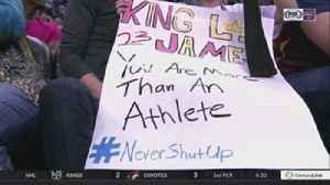 News video: LeBron James gives armband to young fan with #NeverShutUp sign
