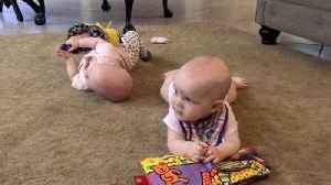News video: Adorable twin sisters that share birthday with Justin Timberlake stop crying as soon as his singing starts