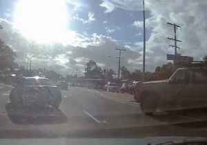News video: Driver Reverses Towards Oncoming Traffic and Mounts Median Strip After Hitting Car