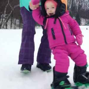 News video: Toddler Snowboards For First Time