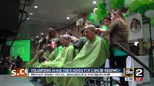 News video: Volunteers shave their heads for childhood cancer research