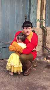 News video: Little Girl Hugs Gaston At A Disney Park And Won't Let Go
