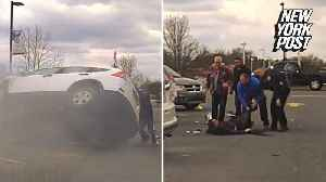 News video: Good Samaritans flip over burning car and rescue man trapped inside