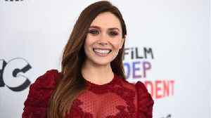 News video: Winona Ryder and Elizabeth Olsen get their tango on in sexy new ad
