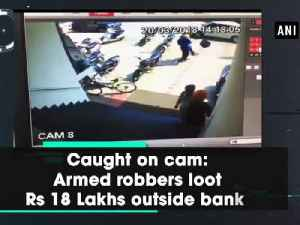 Caught on cam: Armed robbers loot Rs 18 Lakhs outside bank [Video]
