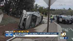 News video: Out-of-control car nearly hits security guard