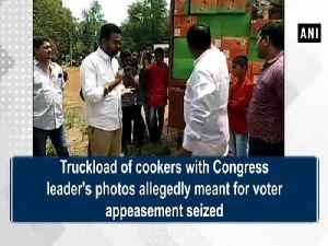 News video: Truckload of cookers with Congress leader's photos allegedly meant for voter appeasement seized