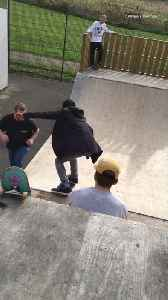 News video: Black jacket kid glasses drops in halfpipe skateboard falls