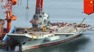 News video: China's first homemade aircraft carrier to go on maiden sea trial