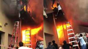 News video: Girls Jump From Balcony to Escape as Fire Engulfs Dance Studio