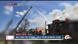News video: Man rescued pregnant woman, child from burning Indianpaolis home