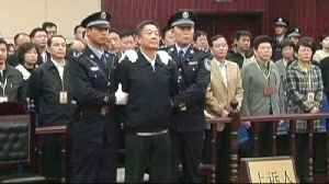 News video: Chinese official pleads guilty to corruption, abuse of power