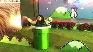 News video: Music black hair woman dances on set of super mario brothers