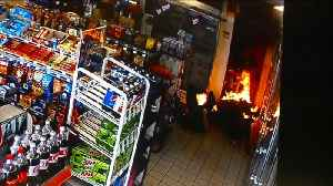 News video: Video Shows Officers Saving Man Who Set Himself on Fire Inside Gas Station