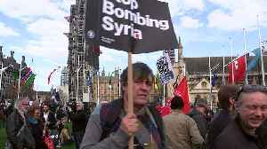 Anti-Syria airstrikes protests outside Houses of Parliament [Video]