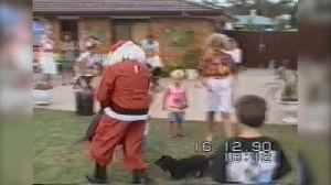 "News video: ""Small Black Dog Barks Madly At Santa And Chases Him Around Yard"""